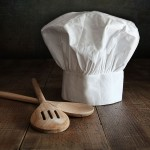 a chef hat and wooden spoons